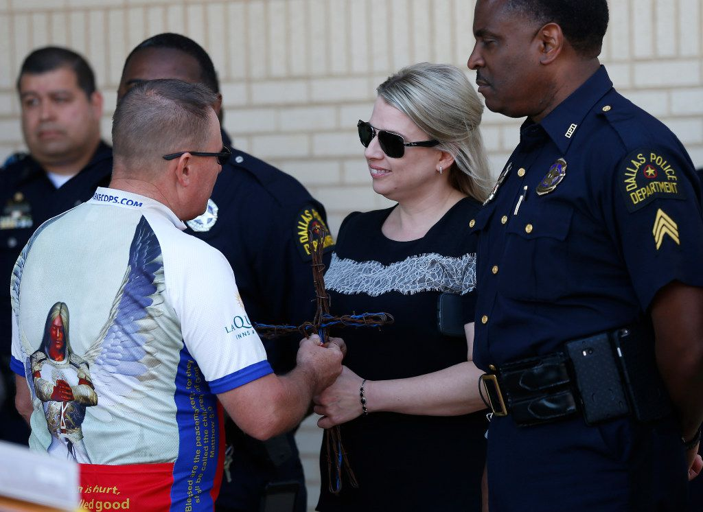 Odessa police Sgt. Dayton Neff gave a handmade memorial to Katrina Ahrens, the widow of Lorne Ahrens, during a ceremony at Dallas police headquarters in April.