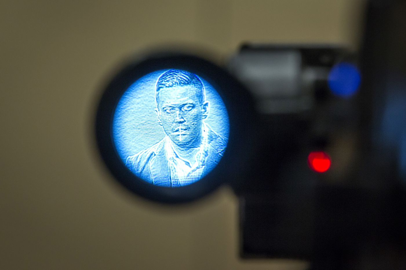 "Richard Spencer is seen in the viewfinder of a video camera as he addresses the media. Spencer drew national headlines after his call to ""Hail Trump!"" elicited Nazi salutes from a crowd of white nationalists at a conference last month in Washington."
