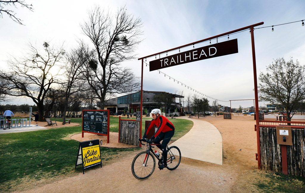 A cyclist enters the Trinity Trails at The Trailhead at Clearfork event area near Press Cafe in Fort Worth. The area is down the street from the Shops at Clearfork development.