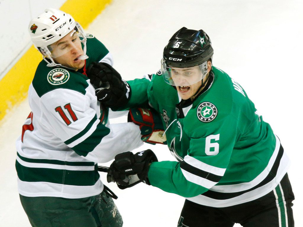 Dallas Stars defenseman Julius Honka (6) gives Minnesota Wild left wing Zach Parise (11) a shot during the first period at the American Airlines Center, Saturday, February 3, 2018. (Tom Fox/The Dallas Morning News)