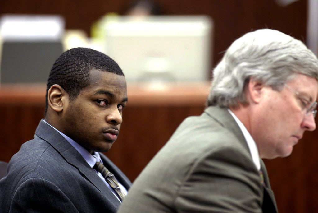 In this Oct. 10, 2005 file photo, Alfred Dewayne Brown (left) is seated next to defense attorney Robert Morrow.
