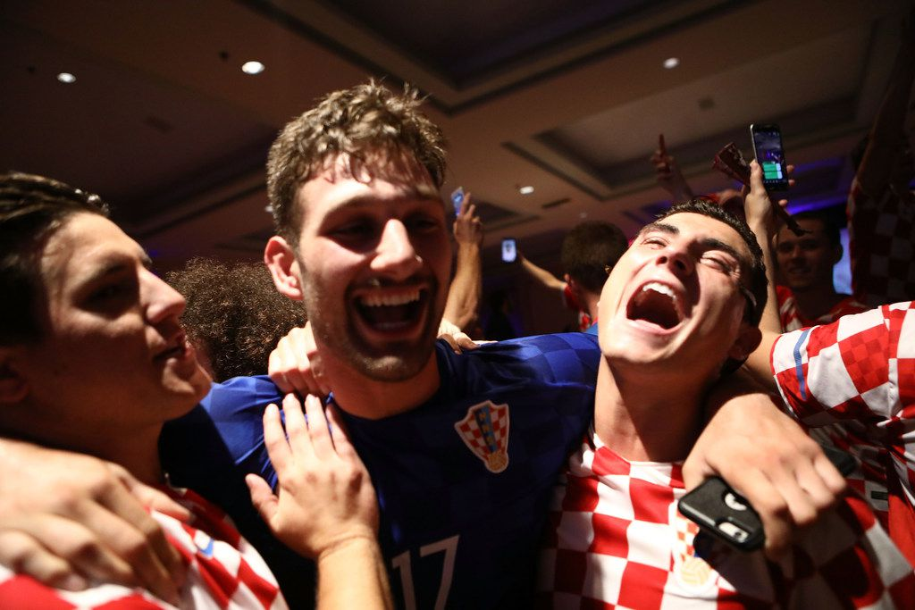 LOS ANGELES, CA - JULY 11:  Croatia fans celebrate at a watch party in Saint Anthony Croatian Catholic Church after Croatia defeated England 2-1 to advance to the World Cup final on July 11, 2018 in Los Angeles, California. Croatia advances to the World Cup finals against France for the first time in Croatian history. It is the country's most important sporting moment since it became in independent nation in 1991.