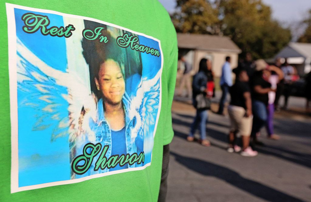 Many attendees of the demolition of the structure at 2208 E. Kiest Boulevard in Oak Cliff south of Dallas, where the body of 13-year-old Shavon Randle was found in July, wore shirts honoring the youth. Photographed on Thursday, October 19, 2017. Randle was kidnapped and held for ransom in a scheme involving drugs, robbery and money in July 2017. (Louis DeLuca/The Dallas Morning News)