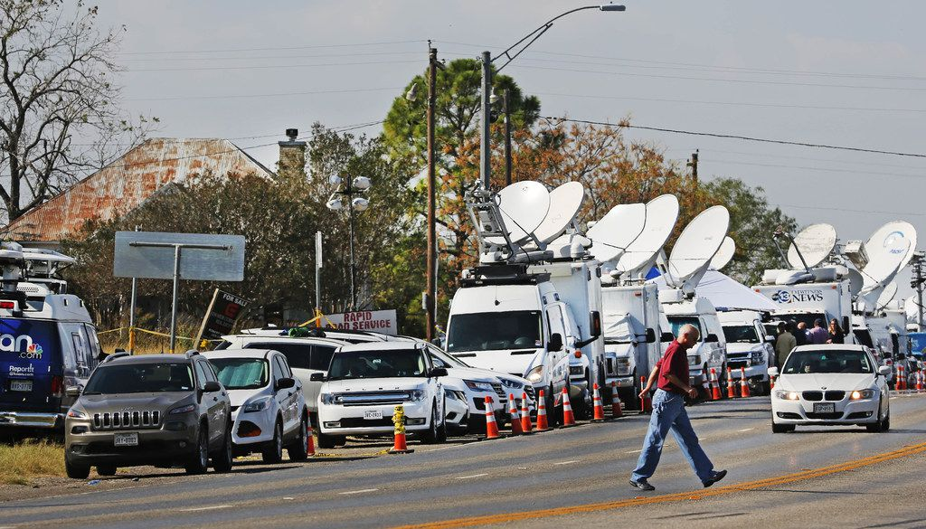 Satellite trucks have lined Highway 87 in Sutherland Springs in the days since the mass shooting at the town's First Baptist Church. (Louis DeLuca/Staff Photographer)