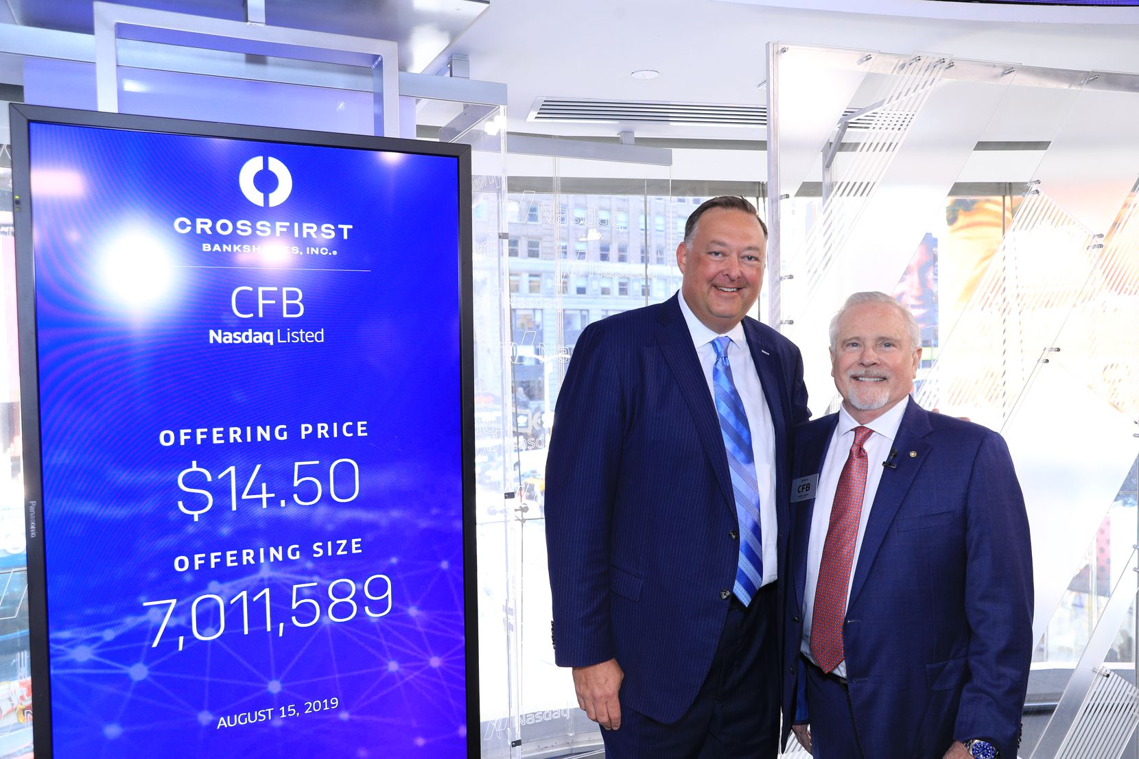 Shares of CrossFirst Bankshares started trading on the Nasdaq on Thursday, Aug. 15, 2019. CrossFirst Bank CEO Mike Maddox, left, and CrossFirst Bankshares CEO George Jones traveled to New York City for the occasion.