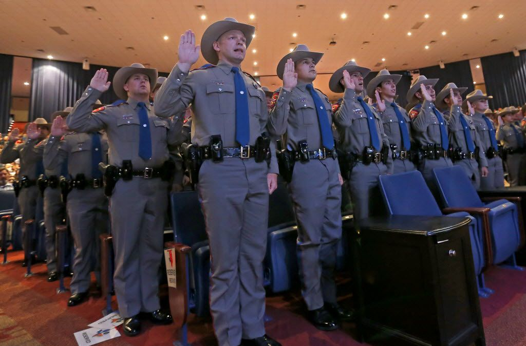 Members of the 155th trooper training class swear an oath during the 155th trooper training class graduation ceremony at Shoreline Church on Friday, June 17, 2016, in Austin.