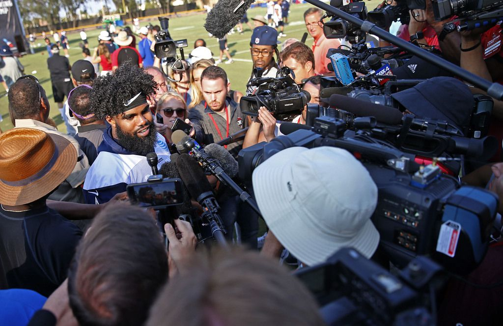 Dallas Cowboys running back Ezekiel Elliott talks with the media after afternoon practice at the training camp in Oxnard, Calif., Friday, July 27, 2018. (Jae S. Lee/The Dallas Morning News)