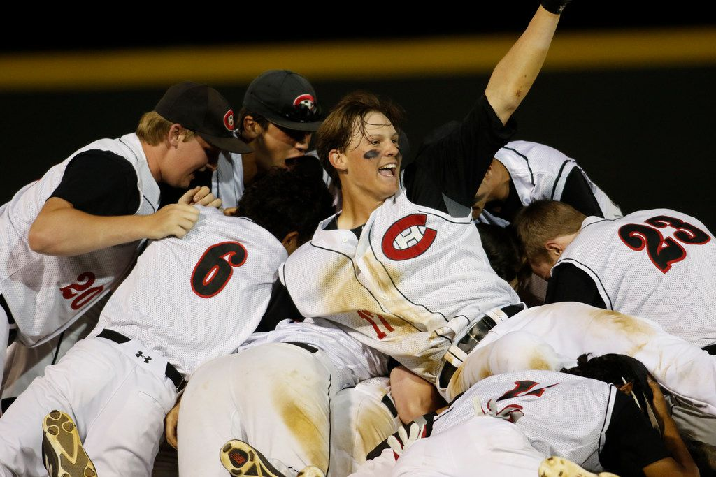 Colleyville Heritage pitcher Bobby Witt Jr. (17) raises his fist as he celebrates with his teammates after they dogsled teammate Mason Greer (5) following his RBI hit in the bottom of the 7th inning to defeat Grapevine, 2-1. The win clinched the district title for Heritage. The two teams played in their District 8-5A baseball game at Colleyville Heritage High School in Colleyville on April 24, 2018. (Steve Hamm/ Special Contributor)