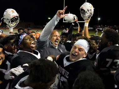 Arlington Bowie coach Danny DeArman celebrates with his players after a victory over Arlington on Friday, Oct. 11, 2019. Bowie can clinch a playoff spot with a win this week. (Smiley N. Pool/The Dallas Morning News)