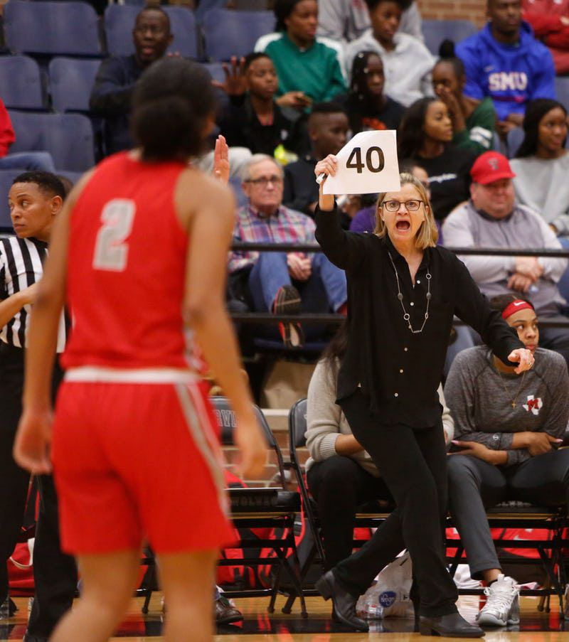 Irving MacArthur head coach Suzie Oelschlegel signals in a play during second half action against DeSoto. The two teams played their Class 6A area-round girls basketball playoff game at Mansfield Timberview High School in Arlington on February 15, 2019. (Steve Hamm/ Special Contributor)