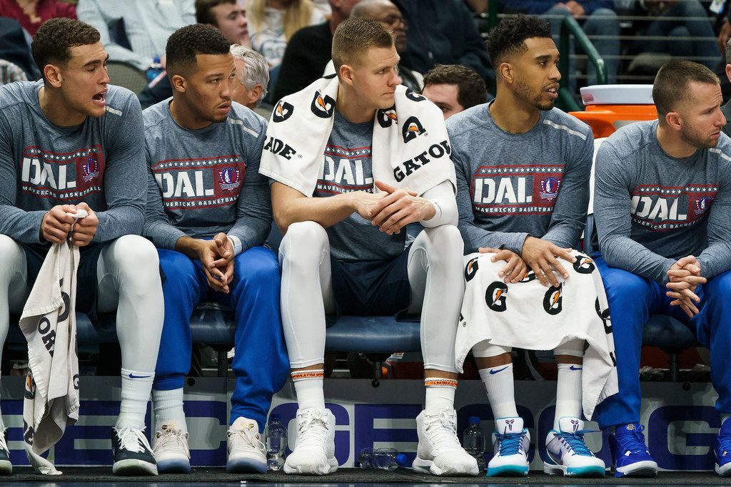 Dallas Mavericks forward Kristaps Porzingis (center) watches from the bench during the first half of an NBA basketball game against the New York Knicks at American Airlines Center on Friday, Nov. 8, 2019, in Dallas. (Smiley N. Pool/The Dallas Morning News)