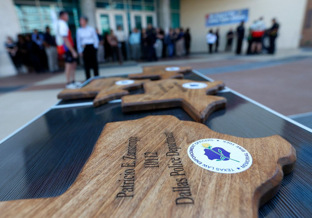 """Memorial plaques bearing the names of Dallas police officers killed in the July 7 attack were presented by the """"We Remember"""" cyclists. (Jae S. Lee/Staff Photographer)"""