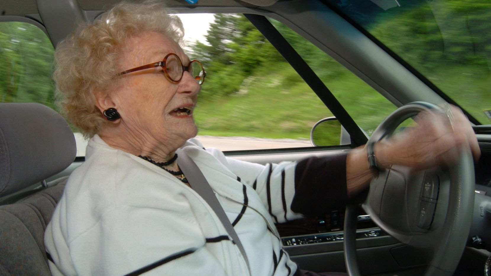 ORG XMIT: *S0409129913* ** ADVANCE FOR THURSDAY, JUNE 10 ** Dorothy Wulfers, 87, who learned to drive a Model T Ford at age 15, drives down a city street June 4, 2004, in Morgantown, W.Va. Wulfers said only her and God will decide when she stops driving. (AP Photo/Dale Sparks) NY348 06132004xNEWS
