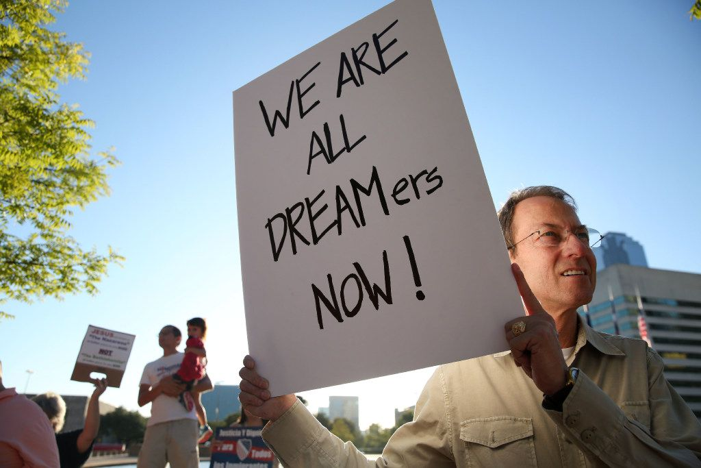Noel Pullam held a sign during a rally for DACA recipients at City Hall Plaza in Dallas last fall.