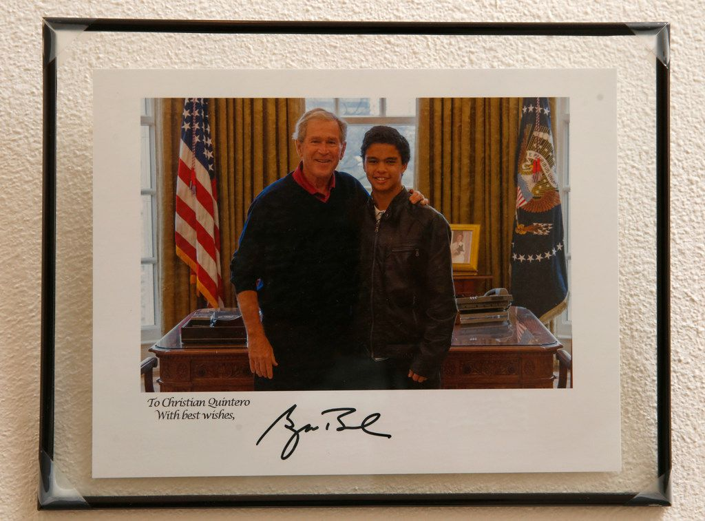 Copy photo of Christian Quintero with former President George Bush in a photo on the wall of Quintero's house in Richardson, Texas on Thursday, June 13, 2019. Quintero is a Dreamer from Colombia, currently attending the University of Texas at Dallas.