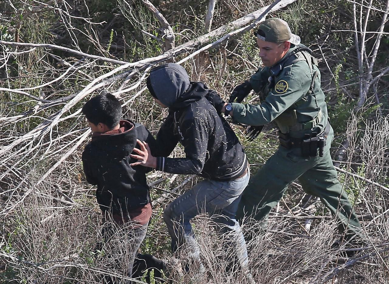 A U.S. Border Patrol agent detained juveniles near the U.S.-Mexico border last month in La Grulla. Border apprehensions usually decrease during winter.