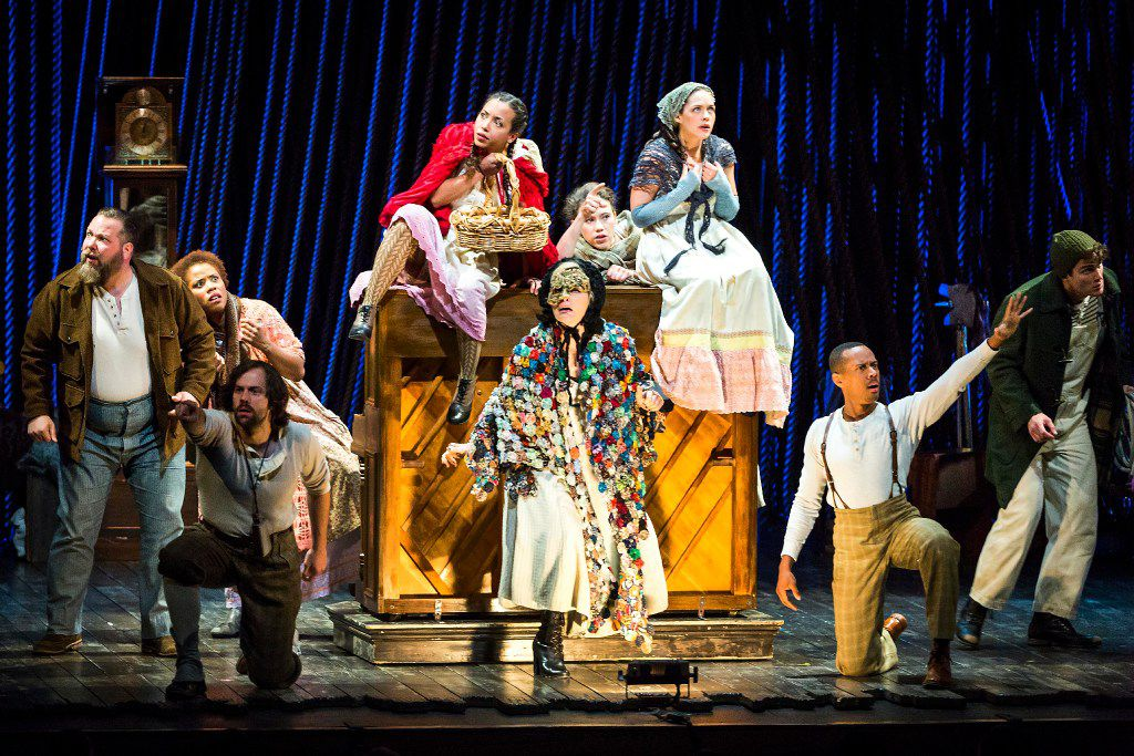 The cast from Into the Woods (from left): Evan Harrington as the Baker, Eleasha Gamble as the Baker's Wife, Darick Pead as Milky White, Lisa Helmi Johanson as Little Red Riding-Hood, Vanessa Reseland as The Witch,  Bonne Kramer as Cinderella's Stepmother/Jack's Mother, Laurie Veldheer as Cinderella, Anthony Chatmon II as Lucinda/Wolf/Cinderella's Prince and Patrick Mulryan as Jack.