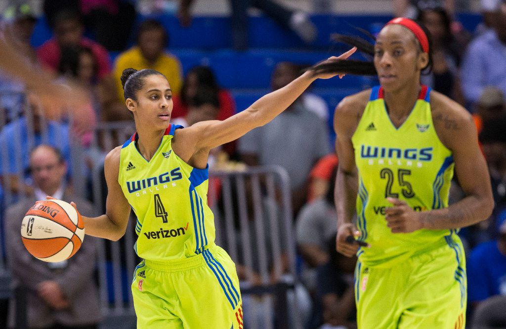 Dallas Wings guard Skylar Diggins-Smith (4) and forward Glory Johnson (25) make their way downcourt in the second half of their game at UTA's College Park Center in Arlington, Texas on June 25, 2017. (Ryan Michalesko/The Dallas Morning News)