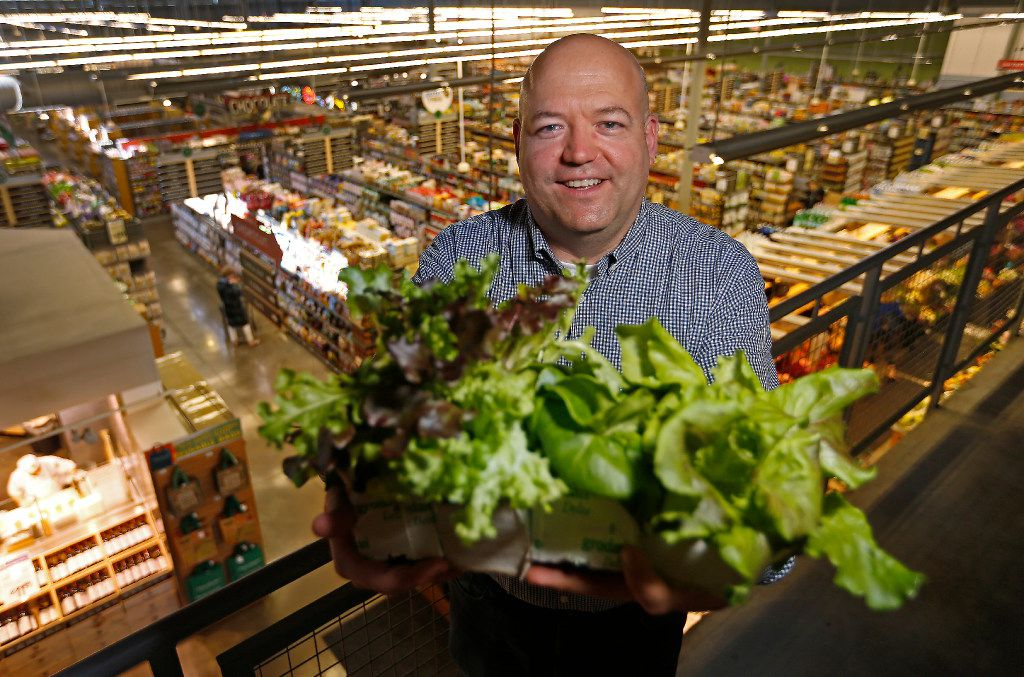 Marty Mika, business development manager of Central Market, poses for a photograph with crops harvested inside a Growtainer unit in the back of the Central Market store in Dallas, Thursday, April 6, 2017. Central Market is trying out indoor growing, and the crops will be sold in the store later this year. (Jae S. Lee/The Dallas Morning News)