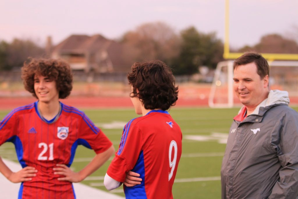 Richardson ISD's J.J. Pearce High School assistant soccer coach Tommy Lamberth, right, suffered head injuries as a teenage soccer player, but he hopes to better educate his players about concussions. (Courtesy/Rick Summey)