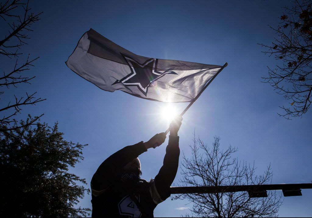 Ramon Barrera of Coppell waves a Dallas Cowboys flag in the parking lot before an NFL game between the Dallas Cowboys and the Philadelphia Eagles on Sunday, December 9, 2018 at AT&T Stadium in Arlington, Texas. (Ashley Landis/The Dallas Morning News)