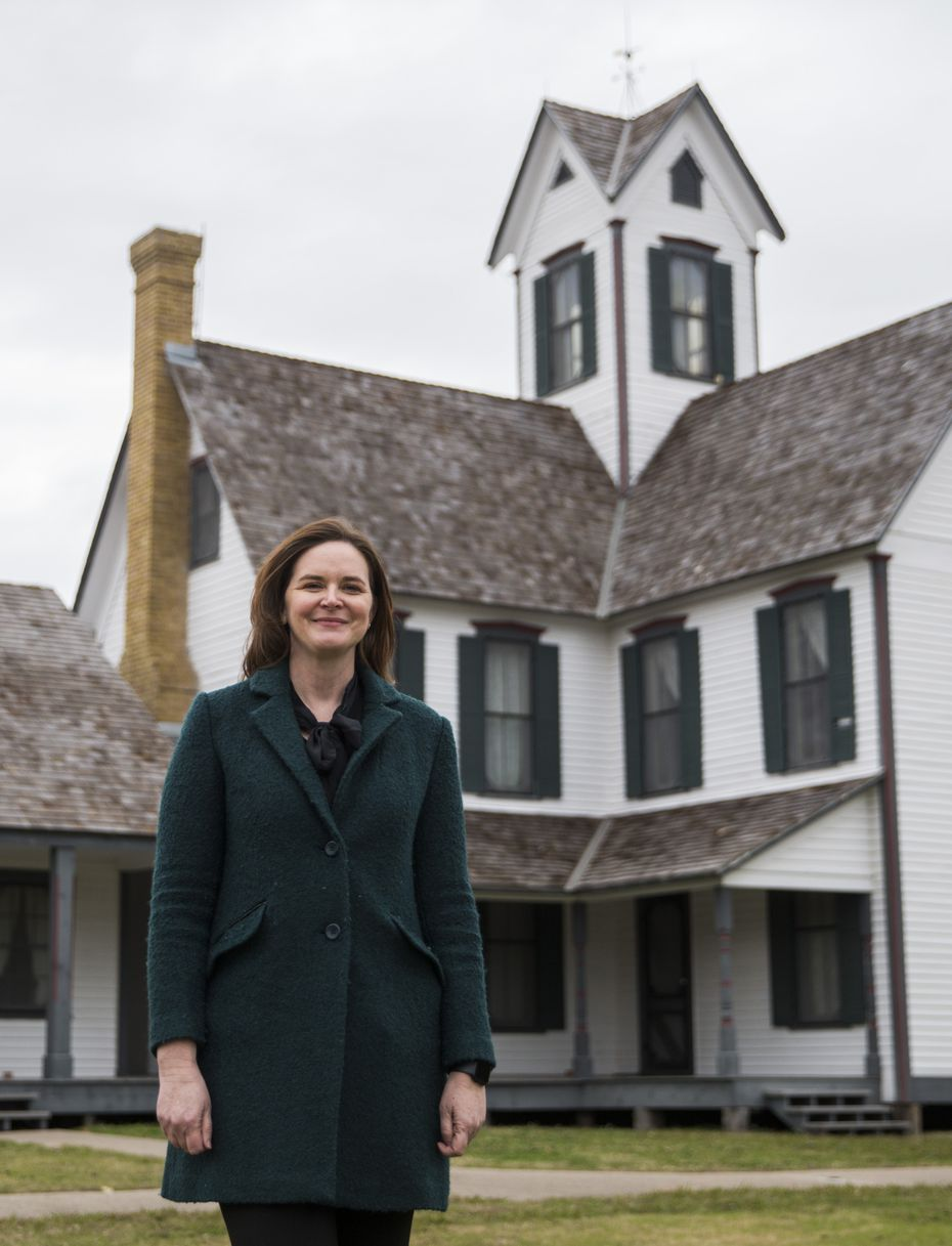 Toyia Pointer, the new city historic preservation manager and executive director of the nonprofit Historic Mesquite Inc., in front of the Lawrence House at Opal Lawrence Historical Park Friday.