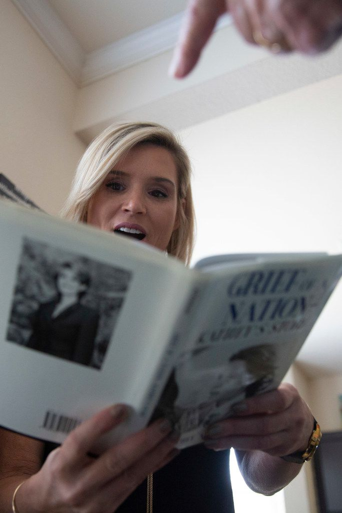 In the Plano home of photographer Eamon Kennedy, KK Robbins looked at a copy of the book that her mother, Kathey Atkinson, published in 1999 about her experience as the subject of an iconic image linked to the Kennedy assassination. A chance meeting aboard a cruise ship would revive memories of that photo for Robbins and sister Katrina Leonard, for whom the photograph was a childhood constant.