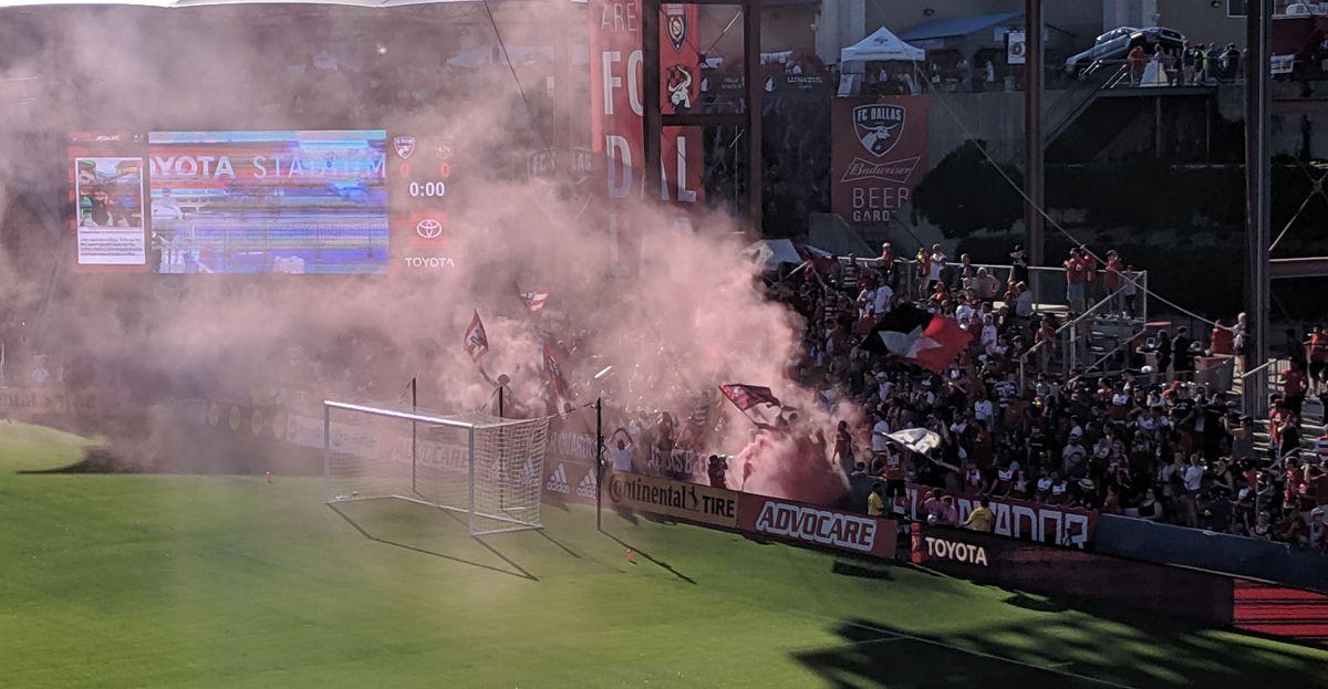 Dallas Beer Guardians and El Matador pop smoke bombs during a 2019 FC Dallas game.