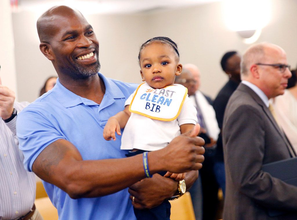 After being formally exonerated of a 1996 murder, exoneree John Nolley Jr gives a thumbs up while carrying his son John Nolley III, following a hearing at the Tim Curry Criminal Justice Building in downtown Fort Worth, Wednesday, October 3, 2018.