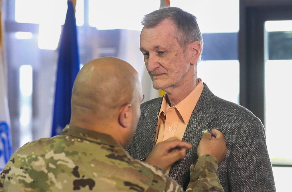U.S. Army veteran Geoff von Wollenberg receives his Vietnam War lapel pin in a ceremony at the Army and Air Force Exchange Service in Dallas on Friday.