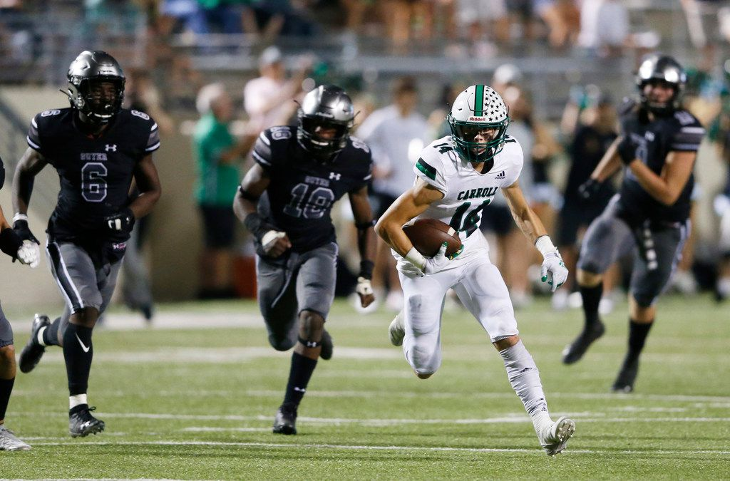 Southlake Carroll's Brady Boyd (14) runs up the field after the catch as Denton Guyer's Jonathan Jones (18) closes in on the play during the first half of play at C.H. Collins Complex in Denton, on Friday, October 4, 2019. (Vernon Bryant/The Dallas Morning News)