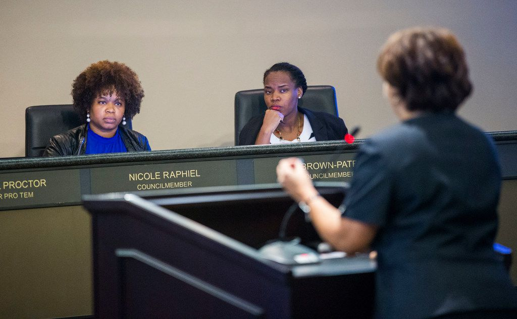 From left, DeSoto City Council members Nicole Raphiel and Kay Brown-Patrick listen to Crystal Owens, DeSoto's managing director of development services, during a DeSoto City Council meeting.