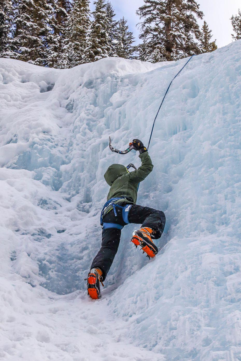 Reid Irwin, 11, climbs a frozen waterfall in Johnston Canyon.