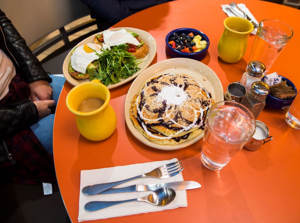 Snooze's BRAVOcado Toast, on the left, is almost upstaged by that giant plate of pancakes. Which seem to be the theme here: Get the pancakes.