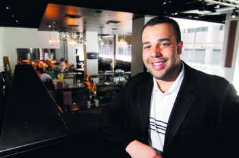 Chad Willis stops by the downtown hot spot AMPM Restaurant & Lounge, one of three Dallas businesses he launched in 2009.
