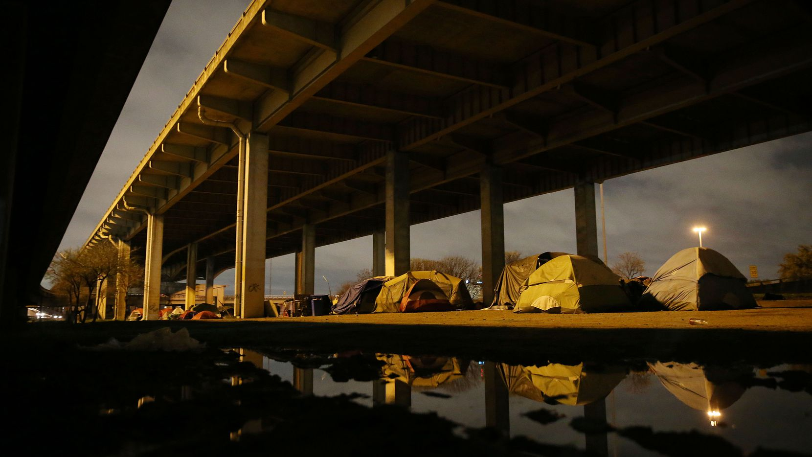 """A view of """"Tent City,"""" the massive homeless encampment under Interstate 45, near downtown Dallas. (Andy Jacobsohn/Staff Photographer)"""