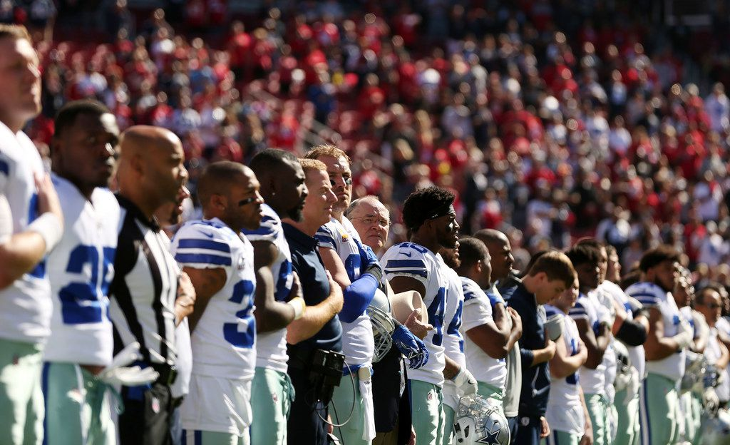 The Dallas Cowboys stand for the singing of the United States National Anthem before a National Football League game between the Dallas Cowboys and the San Francisco 49ers at Levi's Stadium in Santa Clara, California Sunday October 22, 2017. (Andy Jacobsohn/The Dallas Morning News)Up
