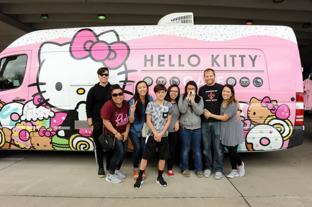 Friends take pictures in front of the famous truck at the Hello Kitty Cafe Truck at The Shops at Willow Bend in Plano, TX on March 12, 2016.