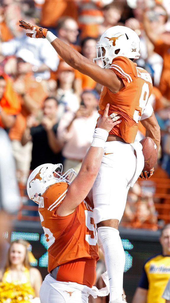 Texas Longhorns wide receiver Collin Johnson (9)celebrates a touchdown with offensive lineman Zach Shackelford (56) against West Virginia Mountaineers in the third quarter at Darrell K RoyalÐTexas Memorial Stadium in Austin Nov. 12, 2016. West Virginia Mountaineers won the game 24-20. (Nathan Hunsinger/The Dallas Morning News)