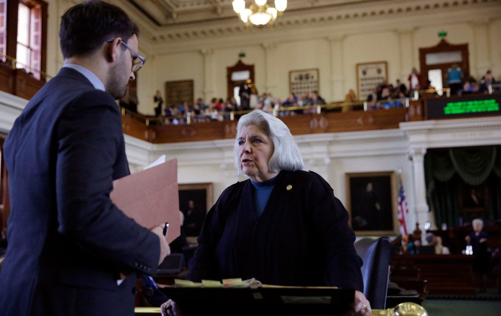 Texas Sen. Judith Zaffirini, D-Laredo, right, talks on the floor before a debate on an anti-sanctuary cities proposal in the Senate Chamber at the Texas Capitol, Tuesday, Feb. 7, 2017, in Austin, Texas.