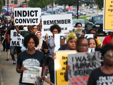 Protesters marched at AT&T Stadium in Arlington last September before a  Dallas Cowboys' game against the New York Giants on Sunday, Sept. 16, 2018 at AT&T Stadium in Arlington, Texas. The demonstration came after Botham Jean was shot in his home by Dallas police officer Amber Guyger.