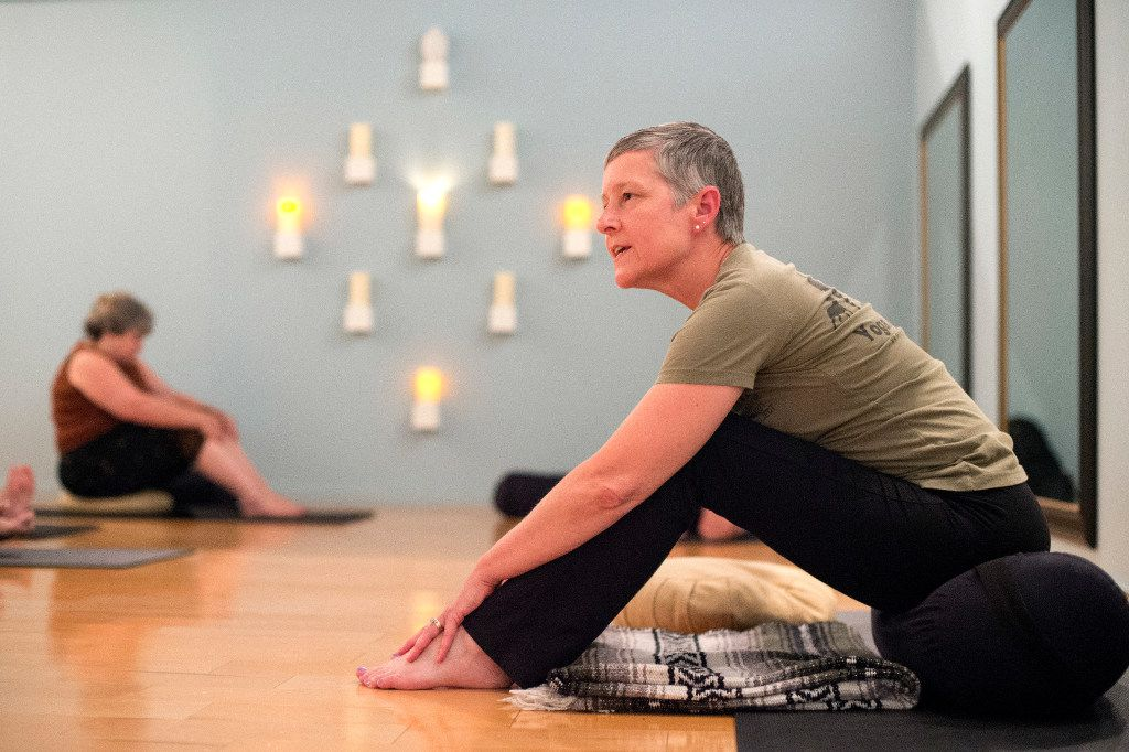 Charla Truesdale, president and co-founder of the non-profit Warrior Spirit Project leads a trauma-sensitive yoga session on Friday, July 21, 2017 at Studio 4 in the Bishop Arts Co-op in Dallas. Warrior Spirit Project seeks to help military veterans and first-responders heal from trauma through yoga, a support dog program, and gardening. (Jeffrey McWhorter/Special Contributor)