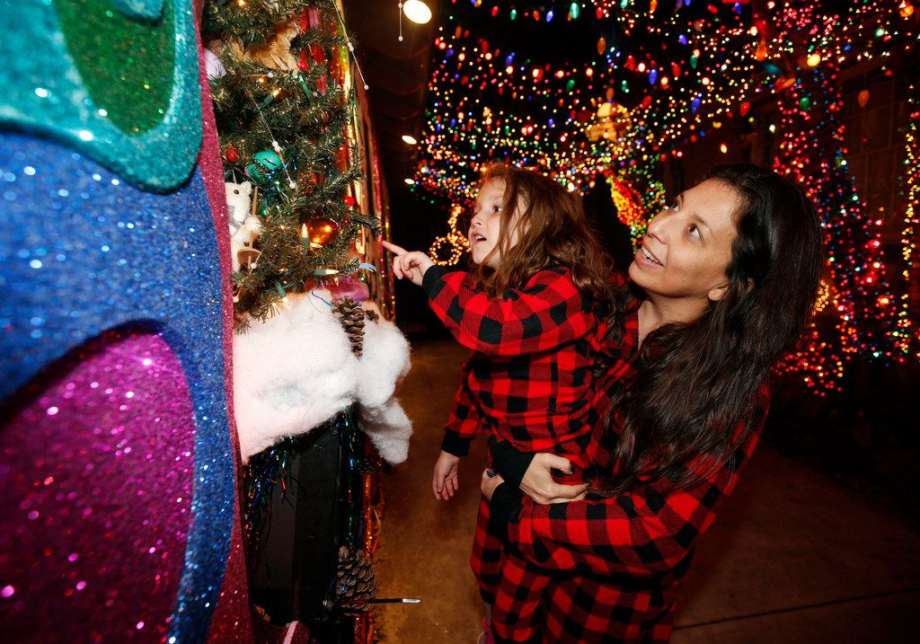 Ana Guerra and Emerson Rogers, 6, toured the display in their pajamas.