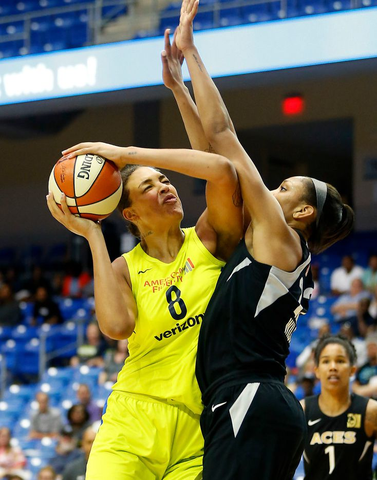 Dallas Wings center Liz Cambage (8) powers Las Vegas Aces center A'ja Wilson during the first half at College Park Center in Arlington, Texas, Sunday, May 13, 2018. (Jae S. Lee/The Dallas Morning News)