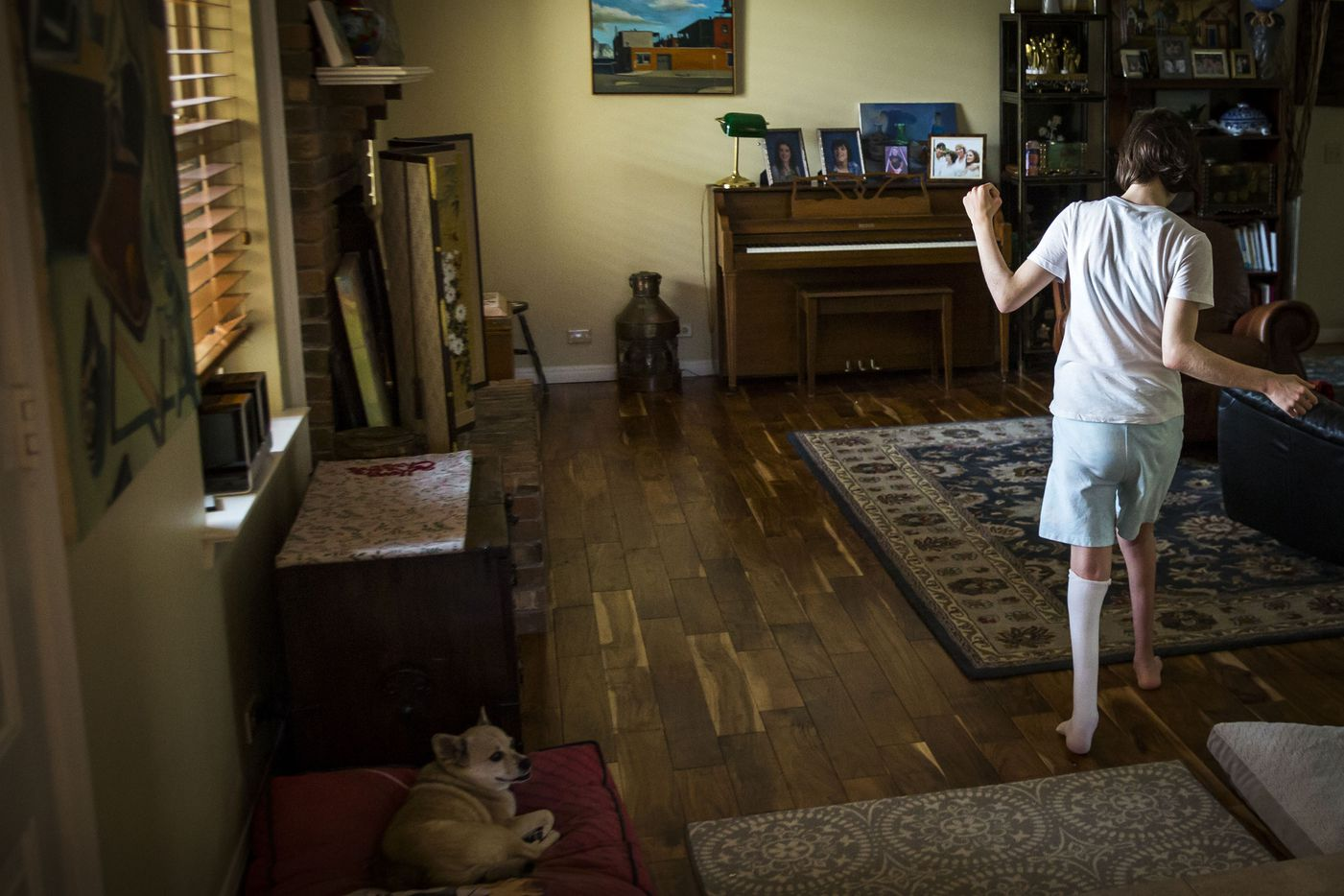 After spending the earlier part of the day agitated and having fits of self-abuse, Kara Zartler dances through her family's home after being treated with cannibis to control her outbursts on Saturday, March 18, 2017, in Richardson. Her family says the only way they can keep Kara from stop striking herself in the head is by giving her marijuana. (Smiley N. Pool/The Dallas Morning News)