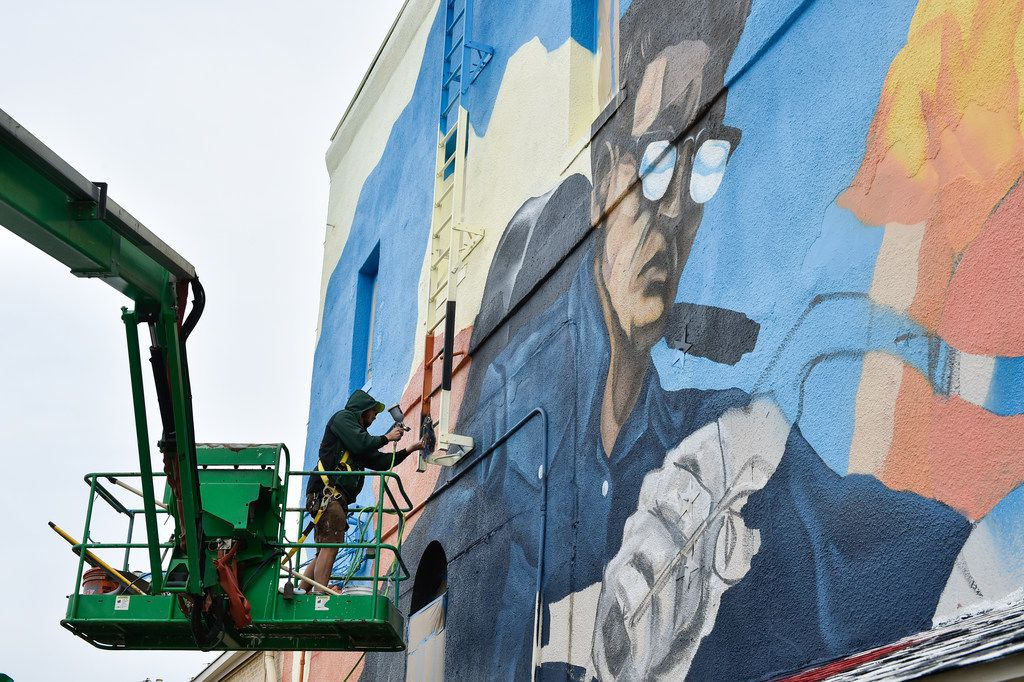 """Local artist Dan Black paints his mural called """"Band on the Run"""" on the outside wall of Andy's Bar & Grill on the Denton Square near the intersection of North Locust Street and East Oak Street. Black described the music-themed mural as a showcase of 1940s and 1950s motorcycle culture. He said he should be finished with it around the middle of next week. Some of Black's art also can be seen around Denton at places such as Bullseye Bike Shop, West Oak Coffee Shop and the Discover Denton Welcome Center., Wednesday, December 6, 2017, in Denton, Texas,"""