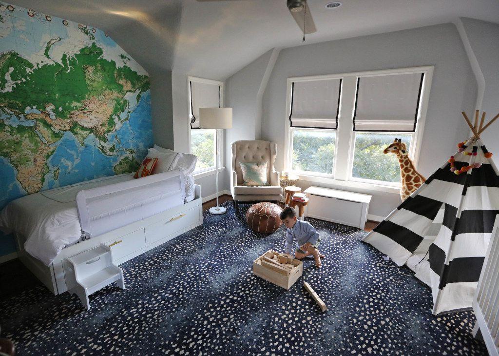 Michael Ruggeri plays in his bedroom at  6935 Lakeshore in Dallas.