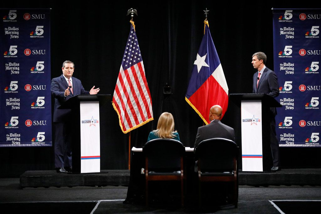 Republican Sen. Ted Cruz makes a comment as Rep. Beto O'Rourke, D-El Paso, waits his turn during a debate at McFarlin Auditorium at Southern Methodist University in Dallas, on  Friday, Sept. 21, 2018.