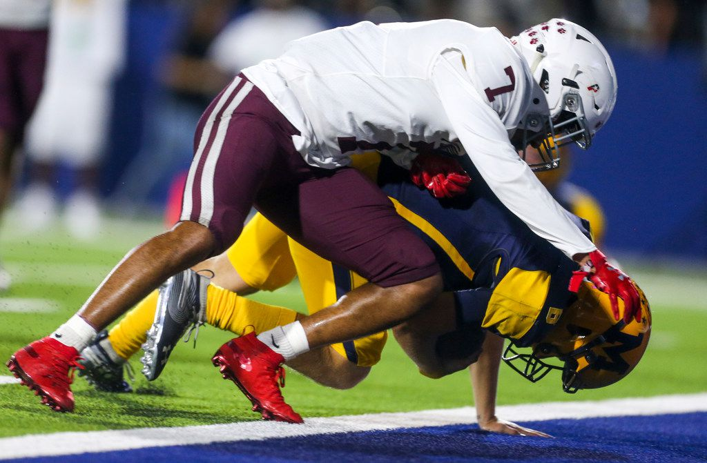 McKinney quarterback Sampson Nazarko (6) dives into the end zone past Plano defensive back Jaylan Bunch (7) for a touchdown during the second half of a high school football game between McKinney and Plano high schools on Thursday, October 10, 2019 at McKinney ISD Stadium in McKinney, Texas. (Shaban Athuman/Staff Photographer)