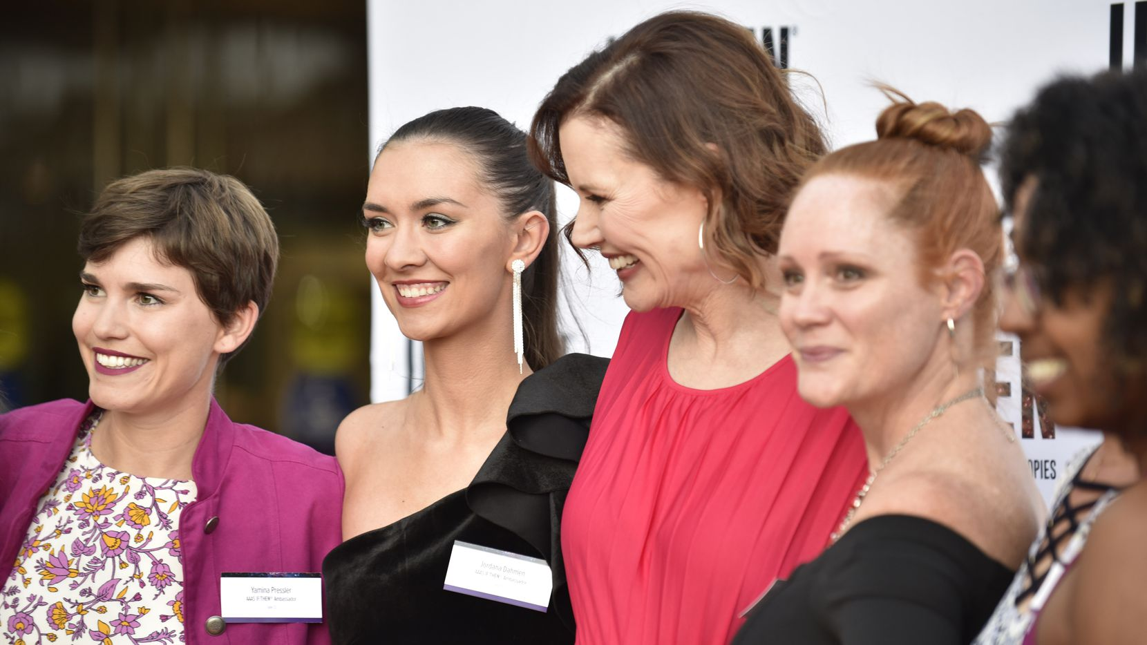"""Yamina Pressler, far-left, and Jordan Damen, left, both IF/THEN Ambassadors, pose for a photo with other ambassadors and actor Geena Davis, third from right, during a red carpet event for the IF/THEN Ambassador Summit """"An Evening of Science and Storytelling,"""" at the Perot Museum of Nature and Science in Dallas, on Monday, Oct 21, 2019. Davis is also the founder of the Geena Davis Institute on Gender in Media. (Ben Torres/Special Contributor)"""